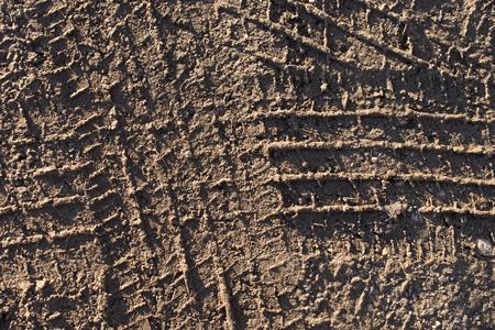 traction: Tire Tracks on Gravel Stock Photo