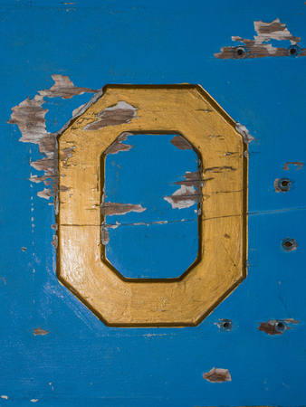 Letter O on Wooden Sign Stock Photo