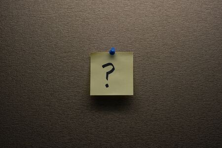 Question Mark Note Pinned to Wall
