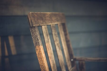 Weathered Rocking Chair on Porch