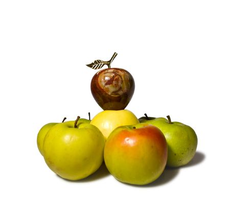 The apple from a stone onyx is above natural apples, expressing thus a principle of hierarchy of structure photo
