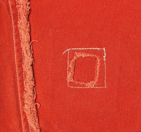 elaboration: Patch on bright jeans orange clothes. Image with high detailed elaboration