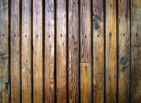 Grungy wooden plank. Damaged, dirty and scratched wood with nails photo
