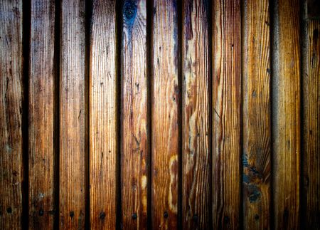 Grungy scratched wooden plank. Dirty and damaged wood with nails photo