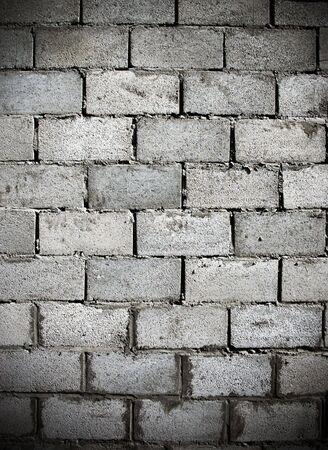 Fragment dark dirty weathered brick wall photo