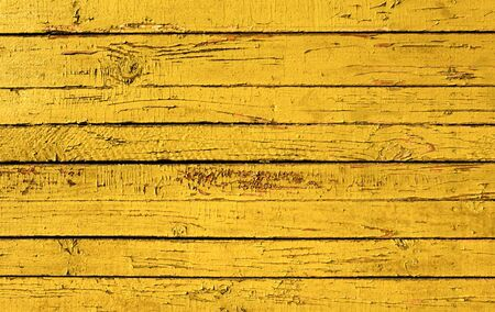 Grunge background from weathered yellow wooden plank photo