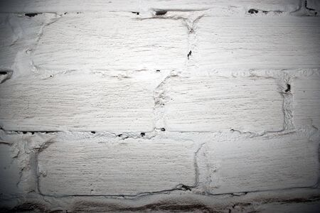 The urban brick wall painted by a white paint photo