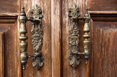 handle: Closeup weathered  wooden entrance with retro door handles