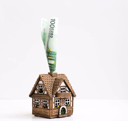 convolute: Tiny cottage with a pipe from a convolute banknote one hundred euros Stock Photo