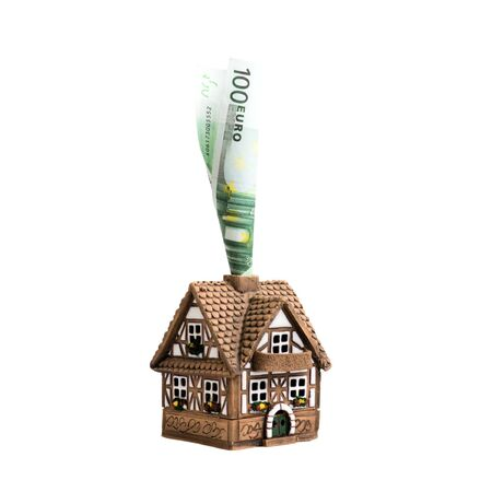convolute: Tiny cottage with a pipe from a con-volute banknote one hundred euros (isolated object)