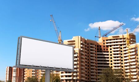 Big blank advertising construction on a urban new buildings photo