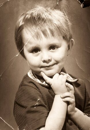 Vintage photo. Tattered and shabby portrait of the little boy Stock Photo - 7324712