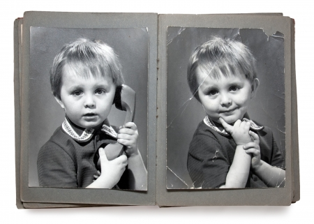 Old album with the children's shabby photos (isolated)