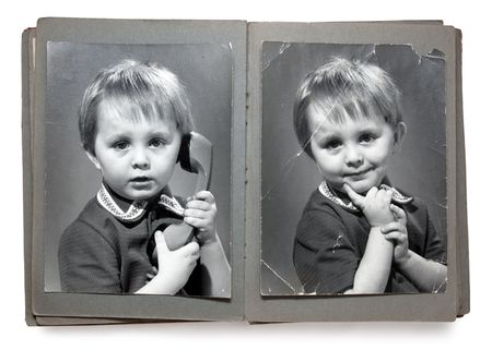 Old album with the childrens shabby photos (isolated) photo