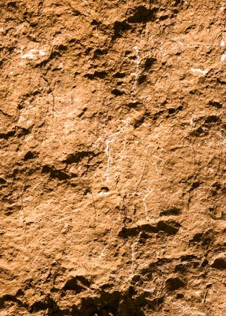 Close-up of the dried up surface of clay photo