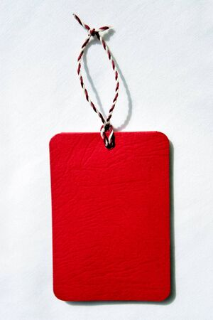 reg: Closeup fragment reg tag on a white fabric