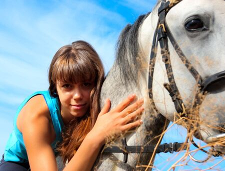 thoroughbred: Beautiful girl riding a horse on nature