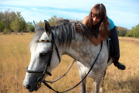 Beautiful girl riding a horse on nature. Selective focus this image Stock Photo - 7903924