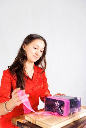 Girl unpack gifts photo