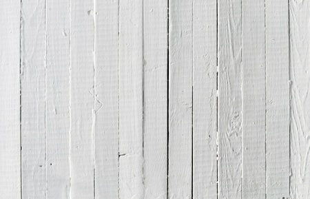 a white background: A background of weathered white painted wood