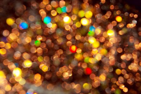 Bright xmas background from un-focus light tinsel photo