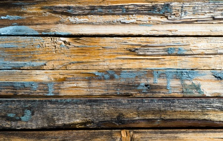 Stained and scratched weathered wooden a plank photo
