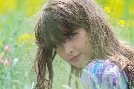 A girl on a nature photo