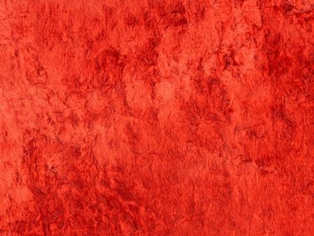 Luxury background of red velvet texture closeup photo