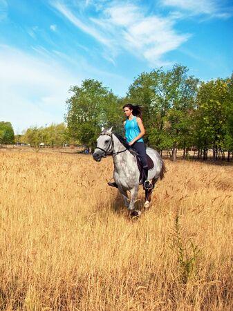 Girl on a horse photo