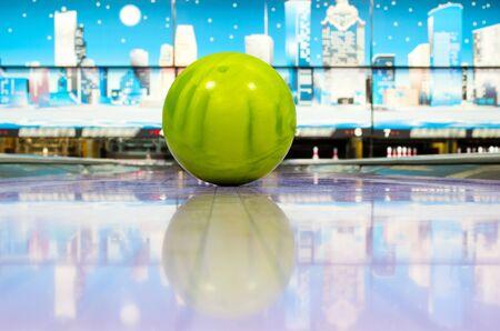 one lane: Sphere ball standing on bowling lane