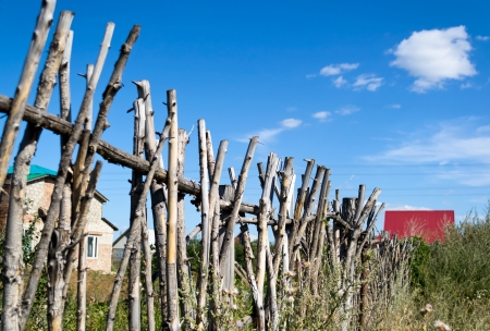 Fence made of tree branches in rural areas photo
