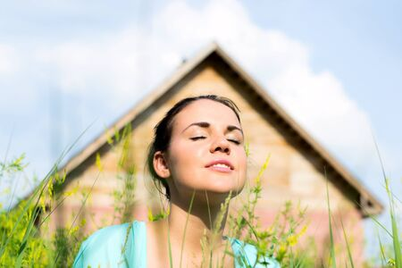Portrait of a beautiful girl against a wooden house Stock Photo - 14808994