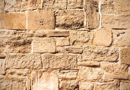 Ancient stone background of old wall  Sepia toned ige photo