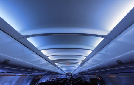 Interior of a commercial airplane  No recognizable faces  Toned image