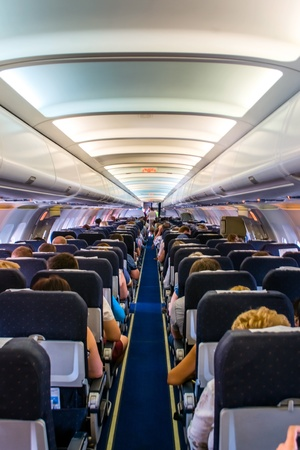 Interior of a commercial airplane  No recognizable faces