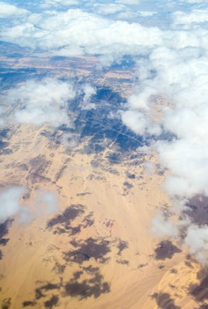 Aerial view landscape near Hurgada town over clouds in Egypt photo