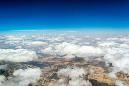high desert: Aerial view landscape near Hurgada town over clouds in Egypt