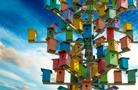 coop: Colorful nesting boxes on blue sky
