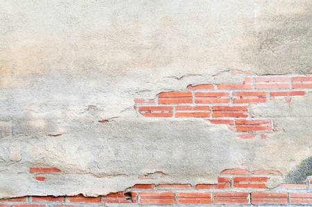 Brick wall destroyed by time and weather conditions photo