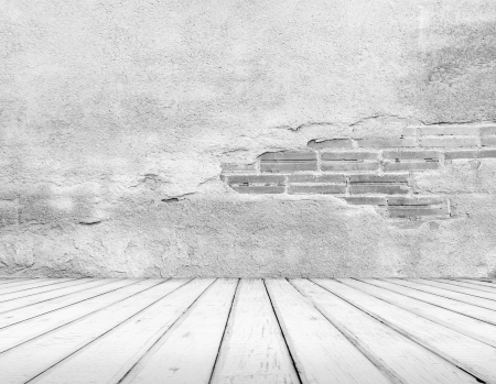 Empty abandoned Interior, vintage background of brick stone wall and wooden floor photo
