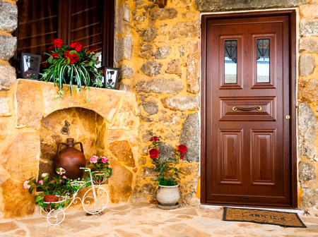 ewer: Charming entrance of courtyard of old mediterranean village Spili