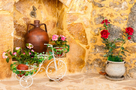 Charming entrance of courtyard of old mediterranean village Spili Stock Photo - 23440004