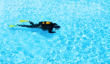trained: Two divers are trained in the pool