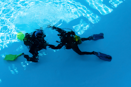 Two divers are trained in the pool photo