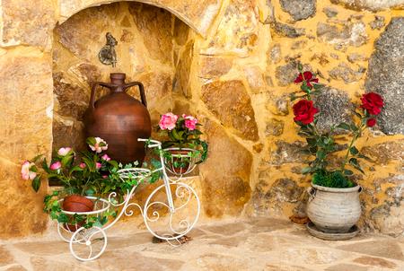 Charming entrance of courtyard of old mediterranean village Spili
