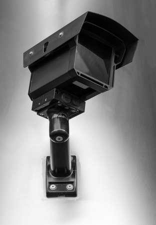 Security camera on the wall. Closeup. Stock Photo