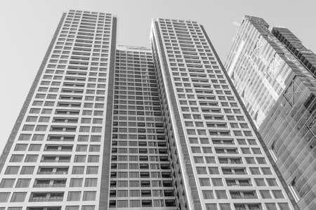 catchlight: Office building skyscraper over sky Stock Photo