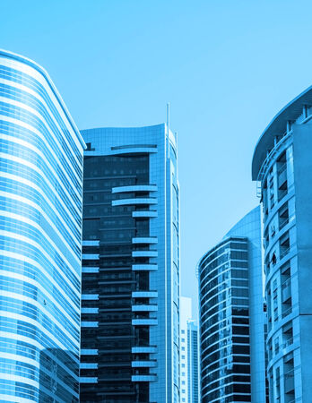 front angle: Modern skyscrapers against blue sky Stock Photo