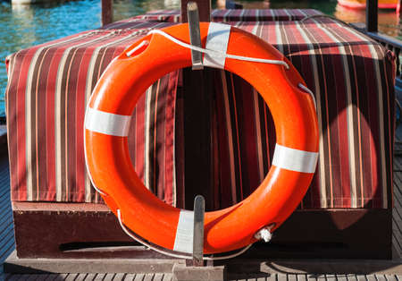 Red and white lifebuoy ring on a boat photo