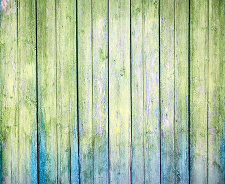 Green weathered plank with the cracked paint photo